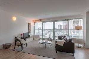 living room one bedroom apartment La Fenetre Den Haag 300x198 - Плюсы и минусы покупки однокомнатных квартир